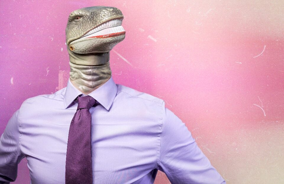 Man wearing pink shirt with dinosaur head