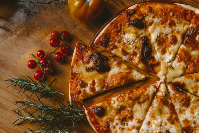 Domino's pizza slice separated from pizza to show digital transformation