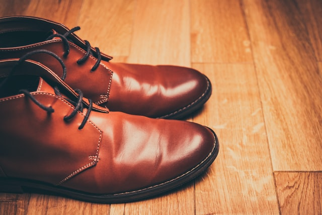 Brown leather shoes on a wooden floor